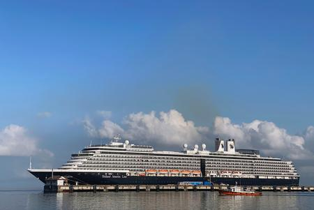 UPDATE 1-American woman from cruise ship tests positive again for coronavirus in Malaysia