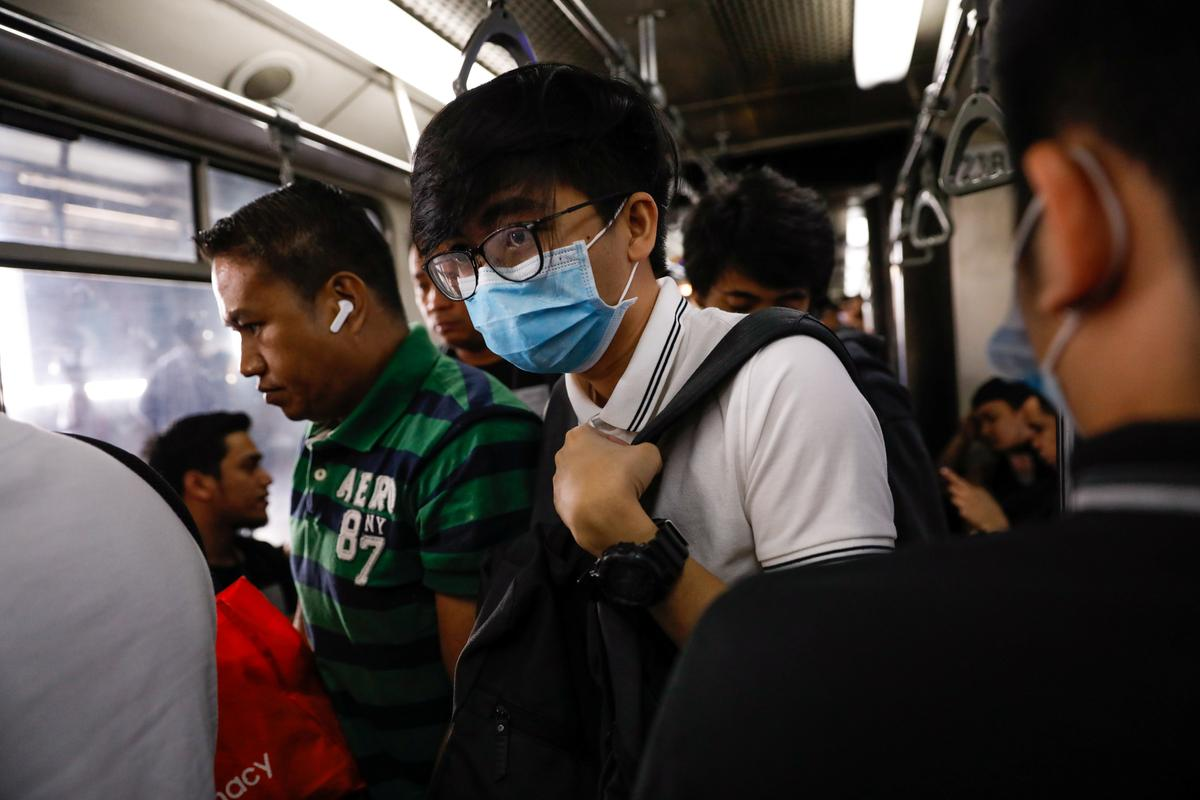 Philippine workers allowed to travel to Hong Kong, Macau amid virus fear