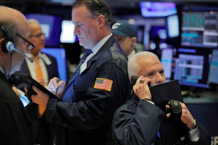 Dow, S&P close lower but Nasdaq edges up after Apple warning