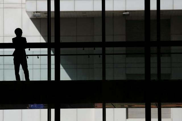 FILE PHOTO: A woman talks on phone inside the Bank of China head office building in Beijing, China March 30, 2016. REUTERS/Damir Sagolj -/File Photo