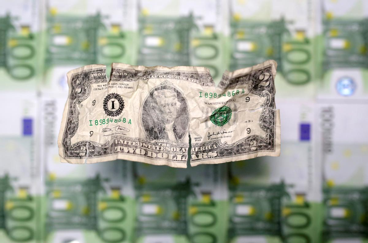 Dollar shines against euro, riskier peers as virus hit widens