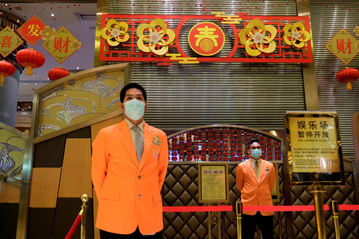 Only masked punters: Macau casinos reopen after coronavirus suspension