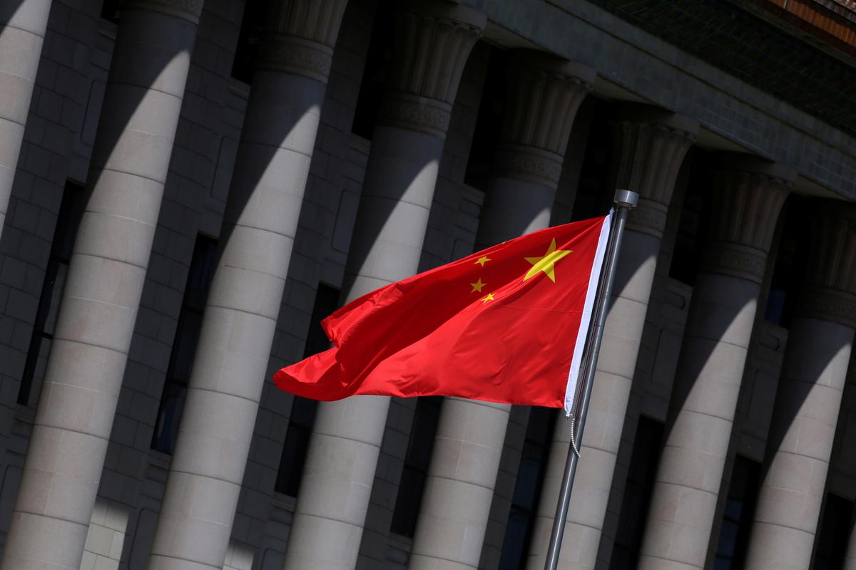 China revokes three Wall Street Journal reporters' credentials