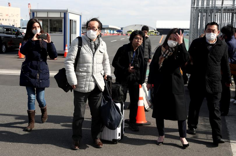 Passengers finally depart coronavirus cruise ship | Pictures | Reuters