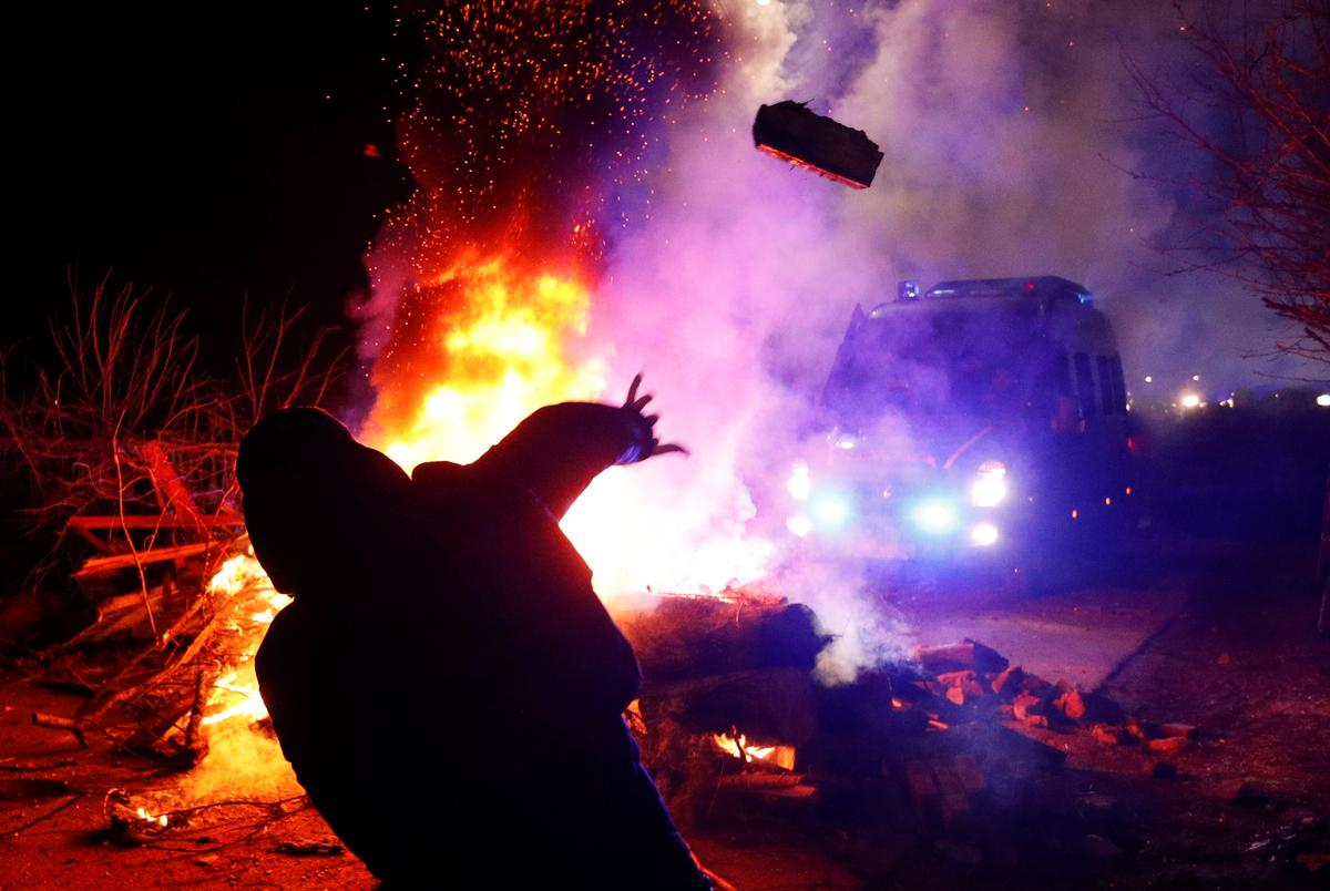 Clashes, jeers and burning tires greet coronavirus evacuees in Ukraine