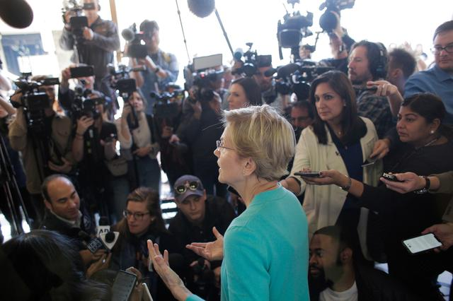 U.S. Democratic presidential candidate Senator Elizabeth Warren answers reporters' questions after she held a ''Canvass Kickoff'' event at her campaign field office in North Las Vegas, Nevada, U.S. February 20, 2020.   REUTERS/David Ryder