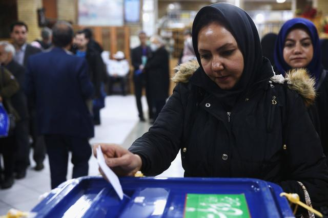 An Iranian woman casts her vote during parliamentary elections at a polling station in Tehran, Iran February 21, 2020. Nazanin Tabatabaee/WANA (West Asia News Agency) via REUTERS