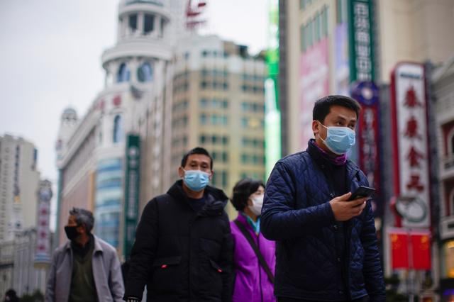 People wear masks at a main shopping area as the country is hit by an outbreak of the new coronavirus in downtown Shanghai, China February 21, 2020. REUTERS/Aly Song