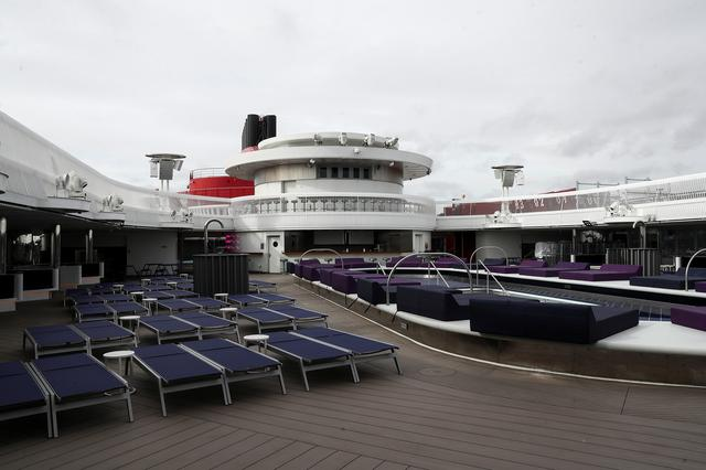 Sun loungers sit on the deck of a Virgin Voyages Scarlet Lady cruise liner at Dover Port in Dover, Britain, February 21, 2020. REUTERS/Simon Dawson