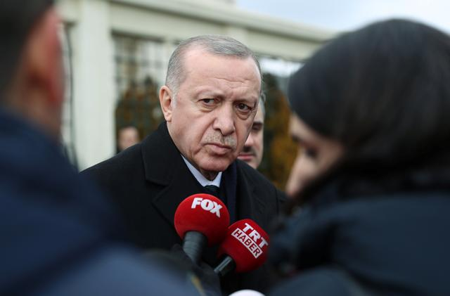 Turkish President Tayyip Erdogan talks to journalists in front of a mosque as he leaves friday prayers in Istanbul, Turkey, February 21, 2020. Murat Cetinmuhurdar/Presidential Press Office/Handout via REUTERS
