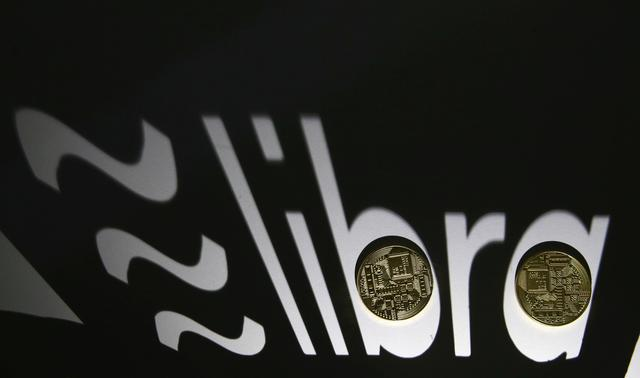FILE PHOTO: Shadow of a 3D-printed Facebook Libra cryptocurrency logo is seen near cryptocurrency representation in this illustration taken, September 13, 2019. REUTERS/Dado Ruvic