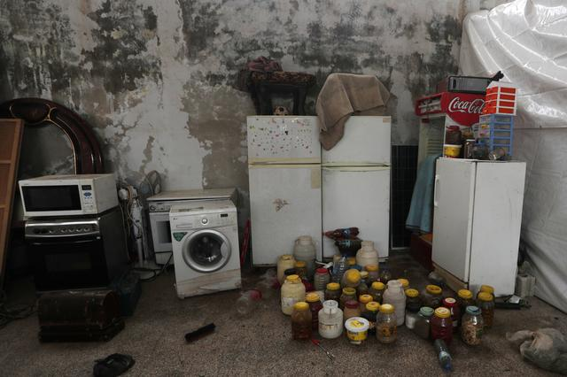 Belongings brought by internally displaced people are pictured at an empty school and university compound used as shelter, in Azaz, Syria February 21, 2020.  REUTERS/Khalil Ashawi