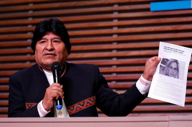 Former Bolivian President Evo Morales holds a paper depicting the image of Bolivia's interim President Jeanine Anez, during a news conference as a reaction to electoral body decision of banning his intention to run as a senator candidate in May election, in Buenos Aires Argentina February 21, 2020. REUTERS/Agustin Marcarian