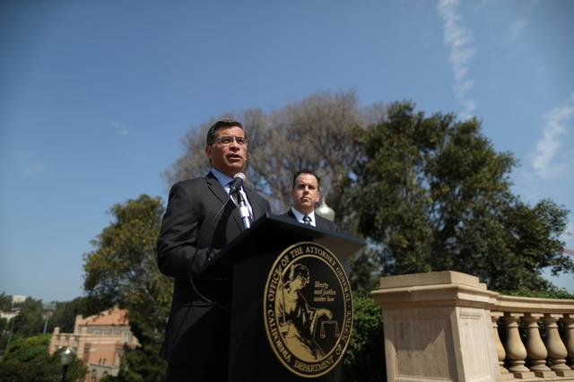 FILE PHOTO: California Attorney General Xavier Becerra (L) speaks about President Trump's proposal to weaken national greenhouse gas emission and fuel efficiency regulations as he stands next to Deputy Attorney General David Zaft, at a media conference in Los Angeles, California, U.S. August 2, 2018. REUTERS/Lucy Nicholson