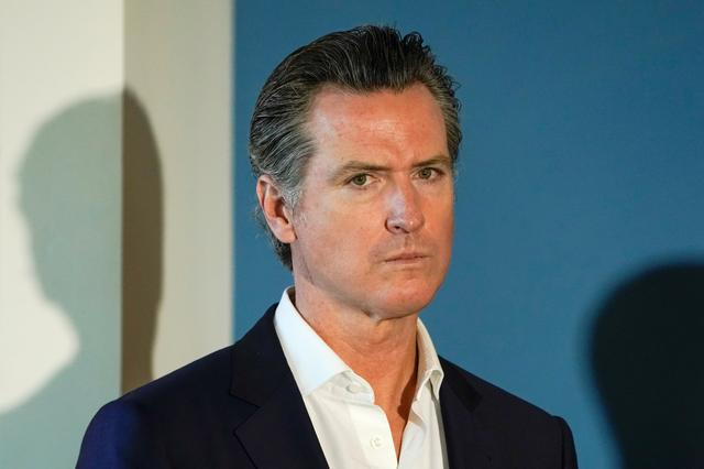 FILE PHOTO:California governor Gavin Newsom waits to speak at a news conference in San Diego, California, U.S. October 9, 2019.  REUTERS/ Mike Blake