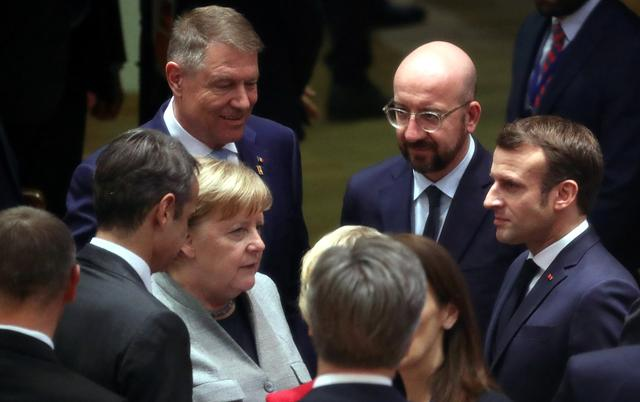 German Chancellor Angela Merkel, Romanian President Klaus Iohannis, European Council President Charles Michel and France's President Emmanuel Macron attend the second day of the European Union leaders summit, held to discuss the EU's long-term budget for 2021-2027, in Brussels, Belgium, February 21, 2020.  REUTERS/Yves Herman/Pool
