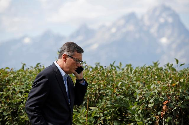 FILE PHOTO: Federal Reserve Vice Chair Richard Clarida talks on the phone during the three-day ''Challenges for Monetary Policy'' conference in Jackson Hole, Wyoming, U.S., August 23, 2019.  REUTERS/Jonathan Crosby