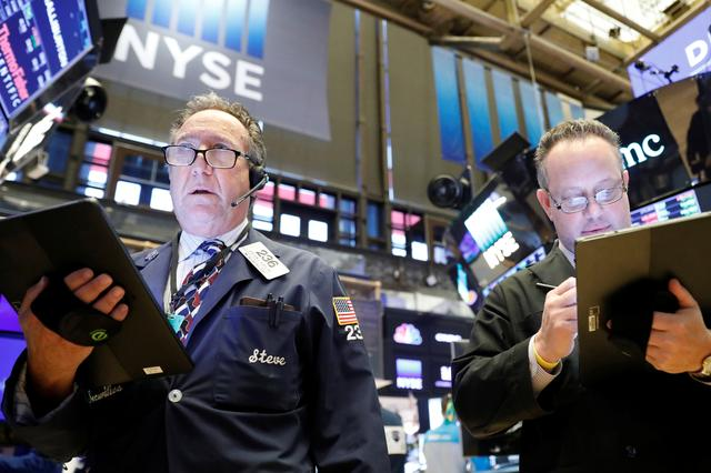 Traders work on the floor of the New York Stock Exchange (NYSE) in New York, U.S., February 19, 2020. REUTERS/Brendan McDermid