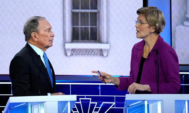 FILE PHOTO: Former New York City Mayor Mike Bloomberg talks with Senator Elizabeth Warren during a break at the ninth Democratic 2020 U.S. Presidential candidates debate at the Paris Theater in Las Vegas Nevada, U.S., February 19, 2020. REUTERS/Mike Blake/File Photo