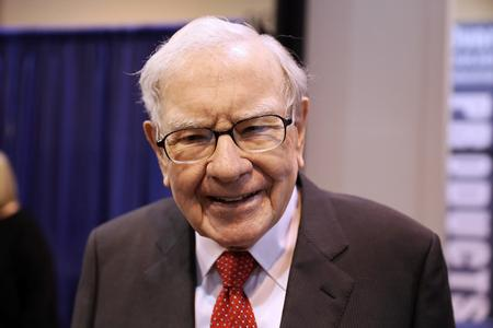 Rising stocks fuel record profit for Buffett's Berkshire; operating profit disappoints
