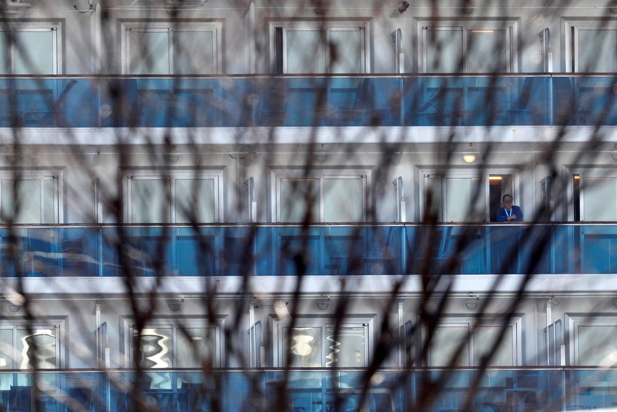 Japan plays down criticism of coronavirus cruise ship handling