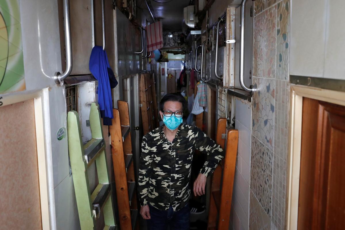 Fearing coronavirus, Hong Kong's 'coffin home' dwellers stay indoors