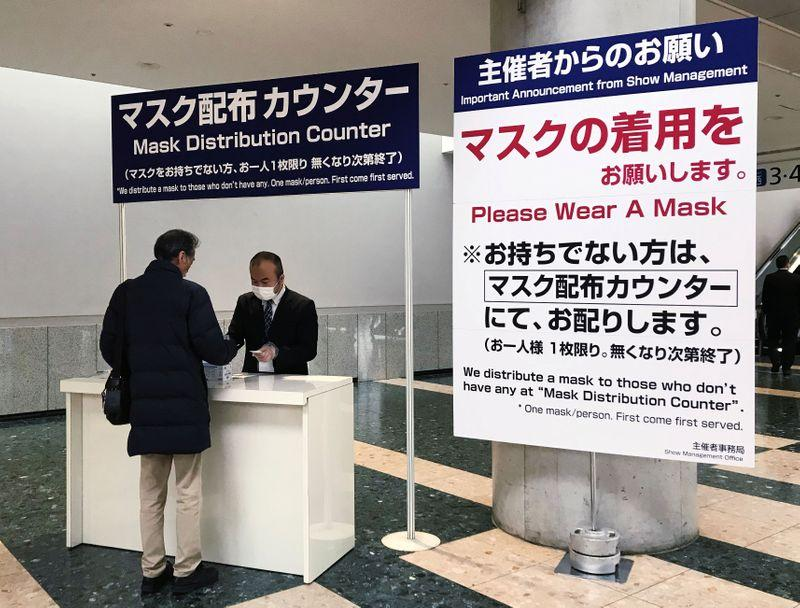 Japan urges firms to have staff work from home over coronavirus; soccer postponed