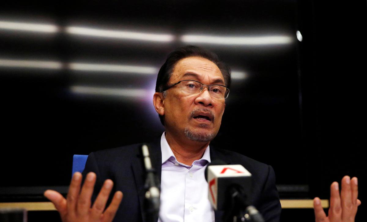 Malaysia's Anwar says he has backing of three parties for PM role