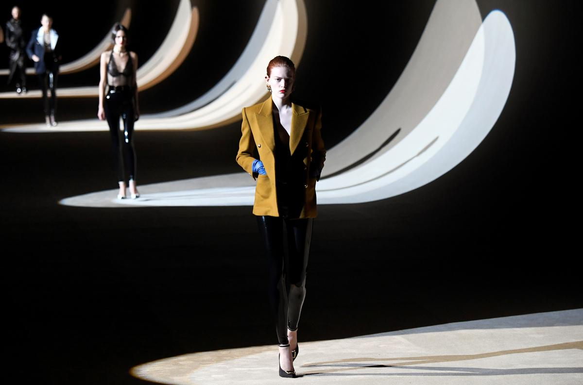 Saint Laurent mixes tweed with fetish-style catsuits for Paris show