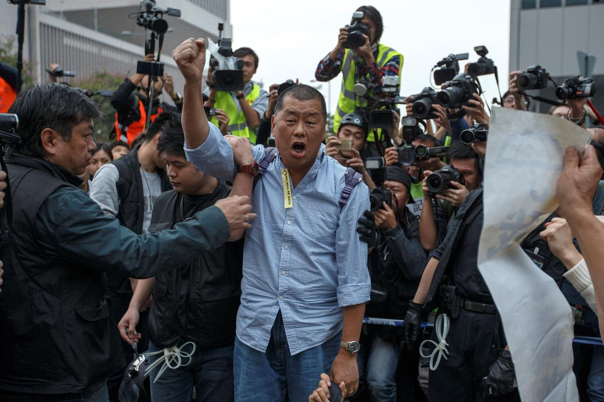 Hong Kong media tycoon Jimmy Lai arrested on illegal assembly charges