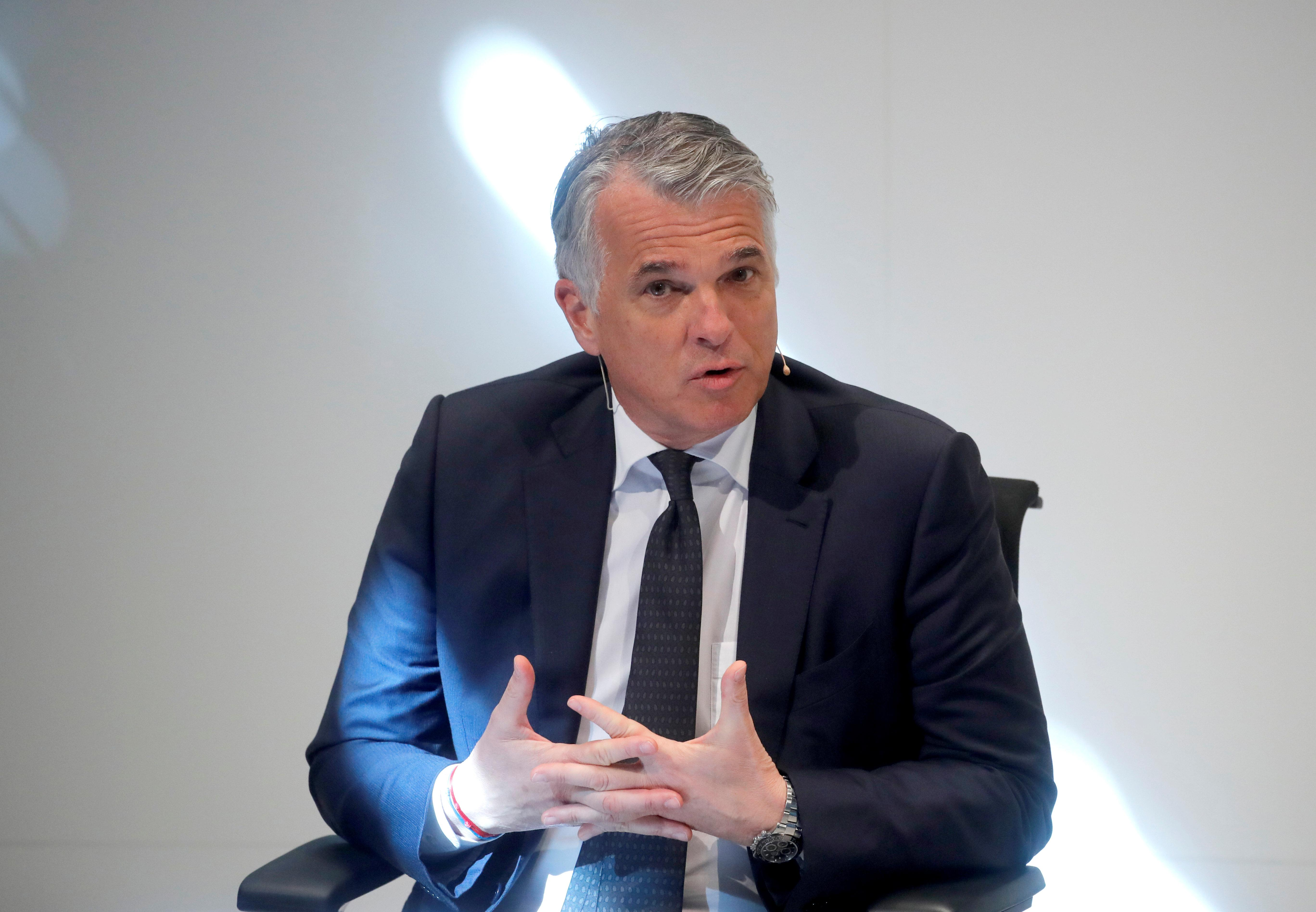 UBS CEO's pay slips to $1 million a month as Swiss bank's top bosses pocket $113 million