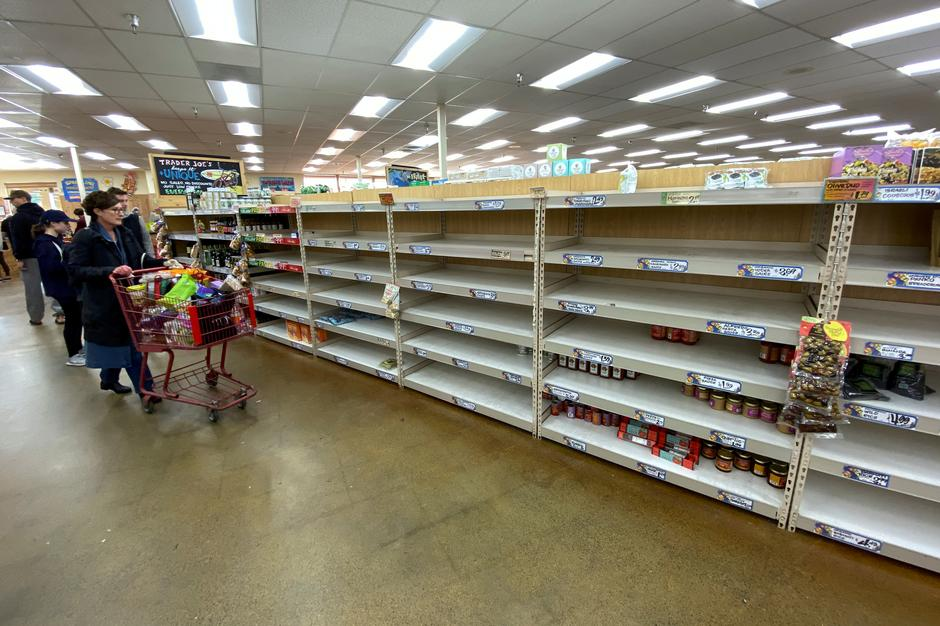 Americans rush to stock up on essentials, retailers scramble to ...