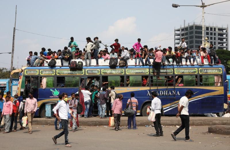 India shuts down flights, big cities as coronavirus toll rises in region