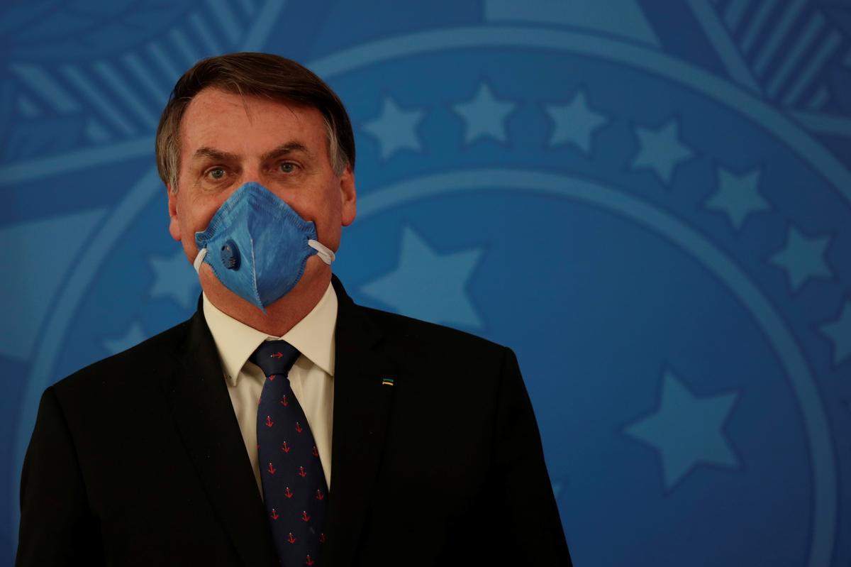 Brazil's Bolsonaro walks back decree to suspend worker pay amid coronavirus