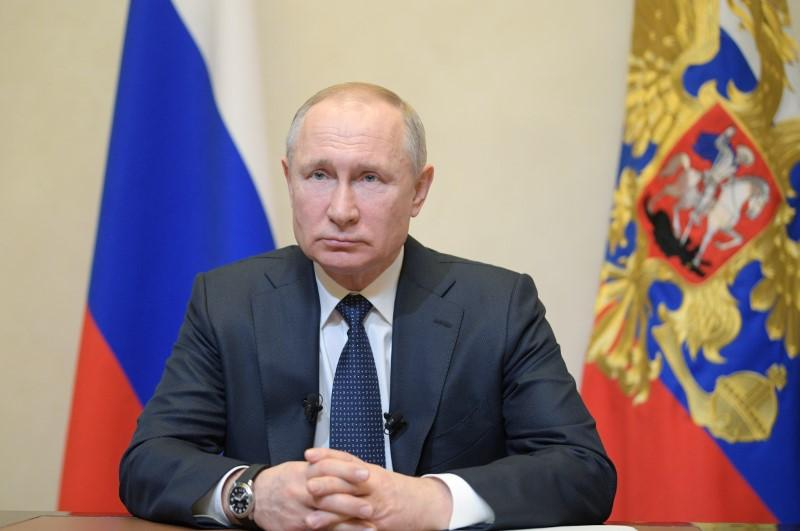 Putin, citing coronavirus, postpones vote on changes that could extend his rule