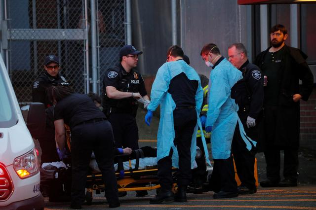 Firefighters, police officers and Emergency Medical Technicians (EMTs) respond to a medical call amid the coronavirus disease (COVID-19) outbreak in Seattle, Washington, U.S., March 24, 2020. REUTERS/Brian Snyder