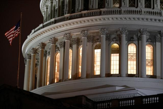 FILE PHOTO: The U.S. Capitol Building as seen ahead of a vote on the coronavirus (COVID-19) relief bill on Capitol Hill in Washington, U.S., March 25, 2020. REUTERS/Tom Brenner