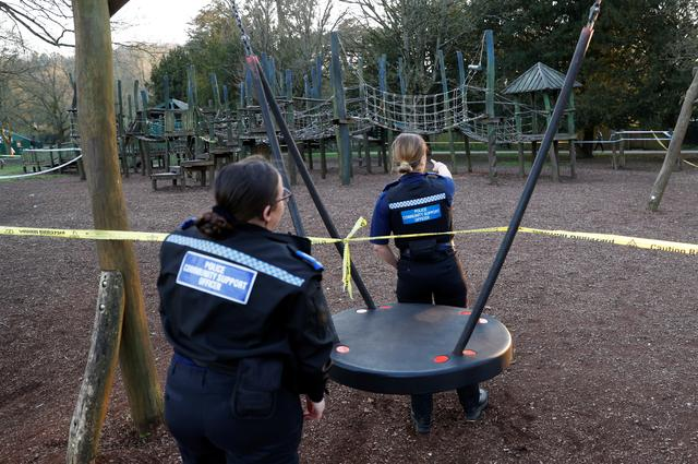 Police officers make sure a play area is not used, as the spread of the coronavirus disease (COVID-19) continues, High Wycombe, Britain, March 26, 2020. REUTERS/Eddie Keogh