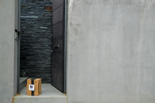 An Amazon package is delivered and left at the door during the coronavirus disease (COVID-19) outbreak in El Masnou, north to Barcelona, Spain, March 26, 2020. REUTERS/ Albert Gea