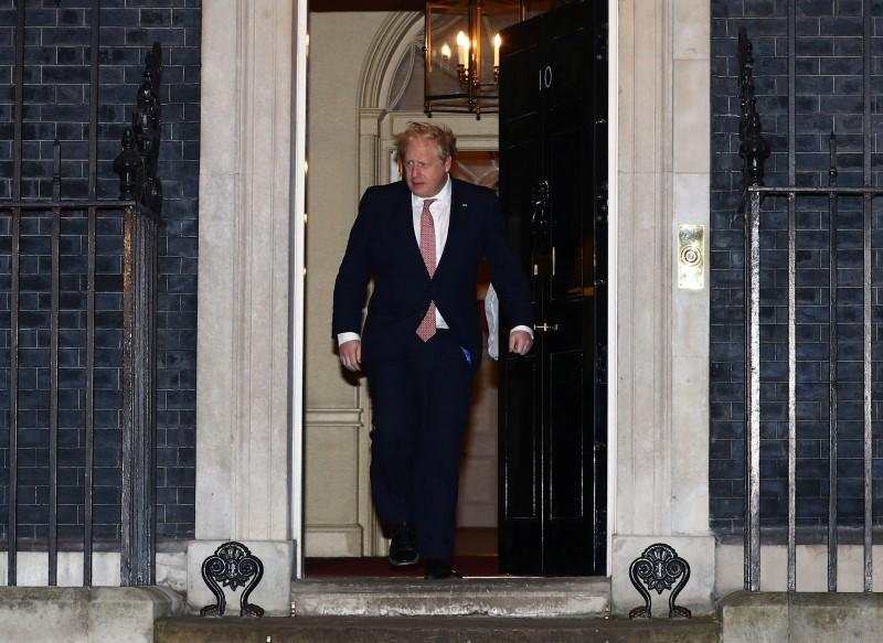 From behind a closed door, infected UK PM Johnson coordinates coronavirus battle