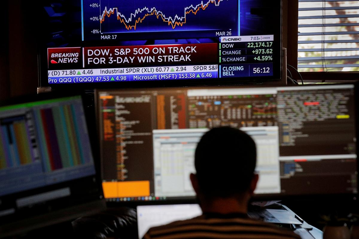 Wall Street tumbles as U.S. virus cases pass 100,000