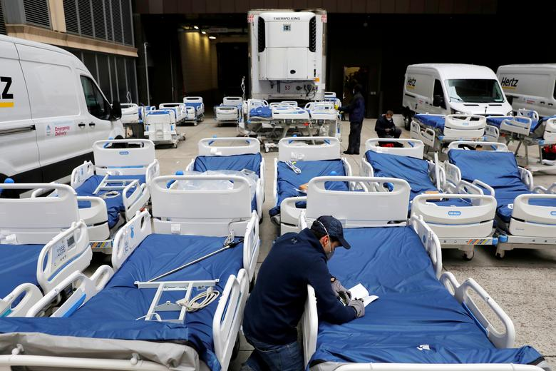 A worker checks part of a delivery of 64 hospital beds from Hillrom to The Mount Sinai Hospital in Manhattan, New York City, March 31, 2020. REUTERS/Andrew Kelly