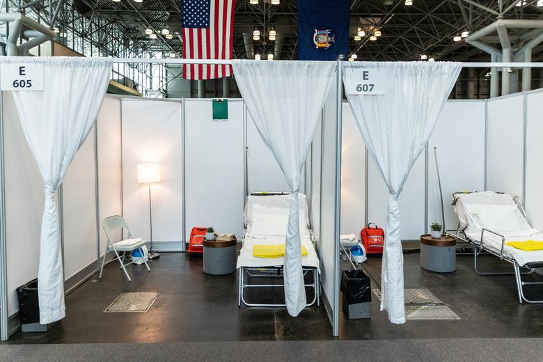 Improvised hospital rooms are seen at the Jacob K. Javits Convention Center, partially converted into a hospital for patients affected by COVID-19 in Manhattan, New York, March 27, 2020. REUTERS/Jeenah Moon