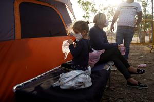 Sprawling Mexican border camp ill-prepared for coronavirus