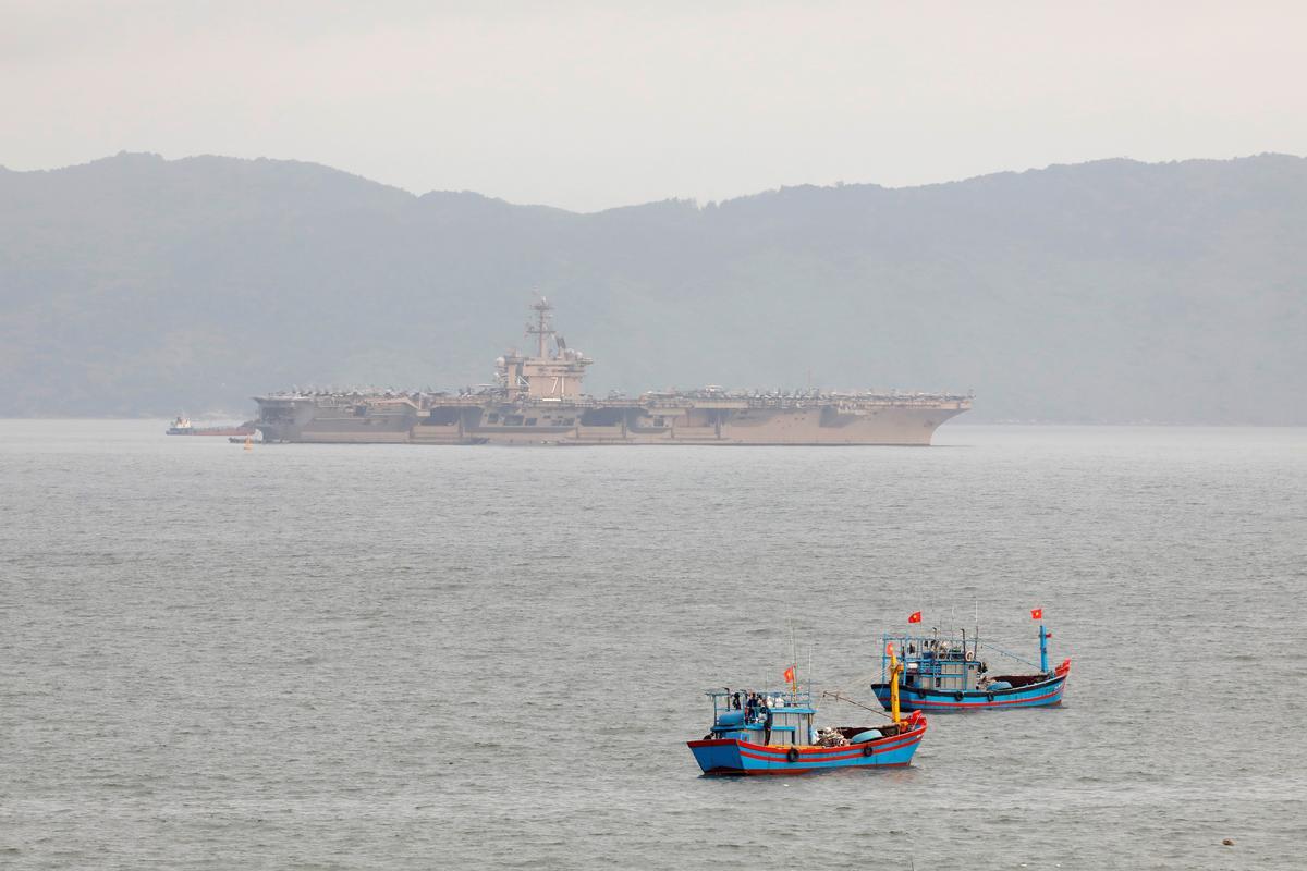 U.S. Navy relieves commander of coronavirus-hit aircraft carrier