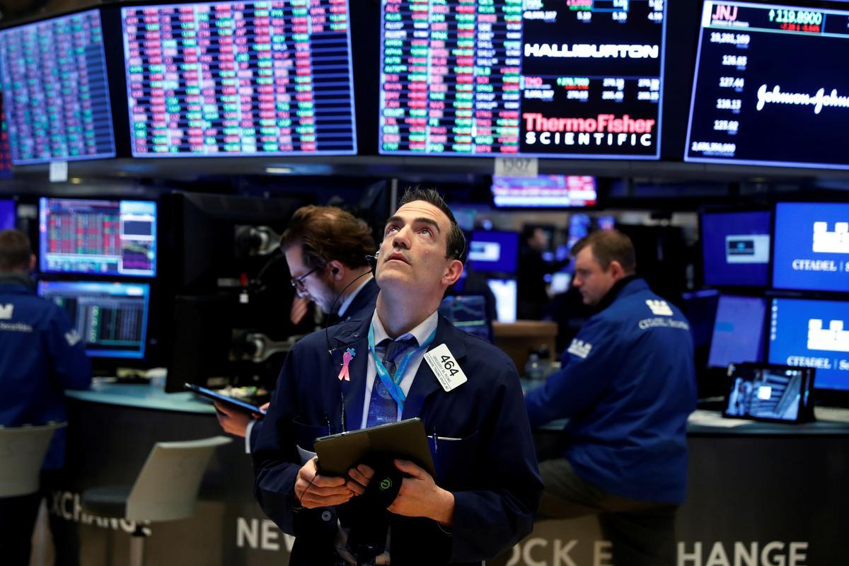 Wall Street falls as coronavirus ends record job growth