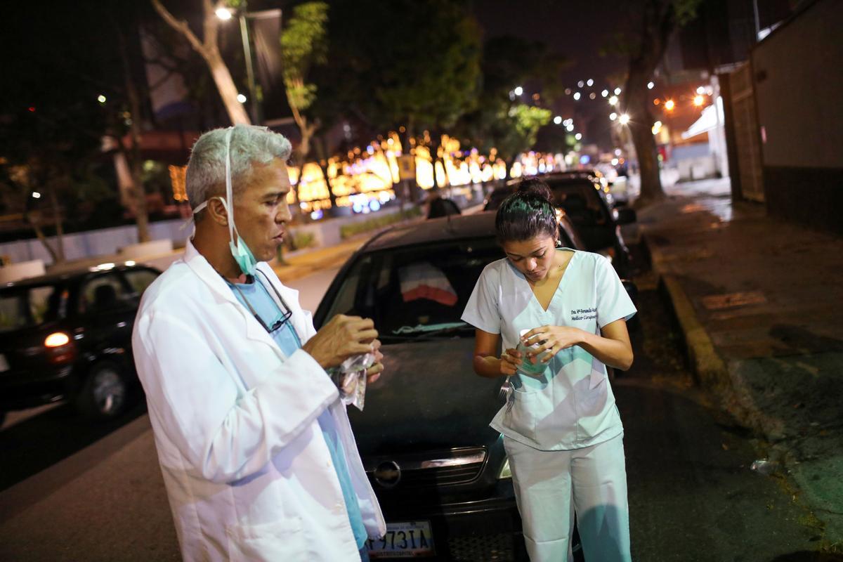 Venezuelan doctors languish in fuel lines amid coronavirus pandemic