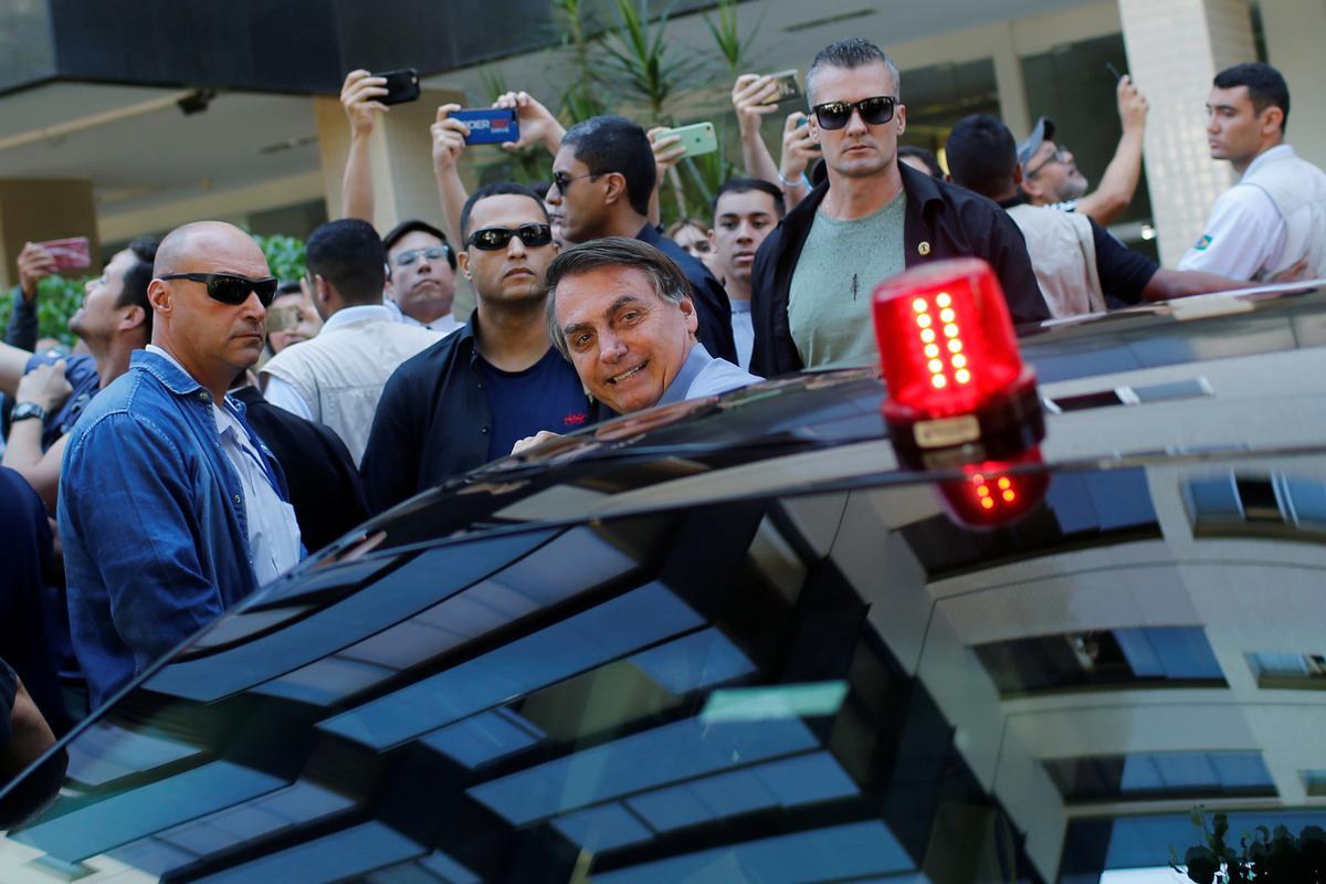 Brazil's Bolsonaro hits the streets in latest social distancing snub