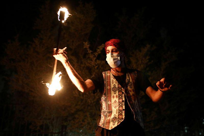 With fire and music performers bring Ramadan to fun-starved Jerusalem