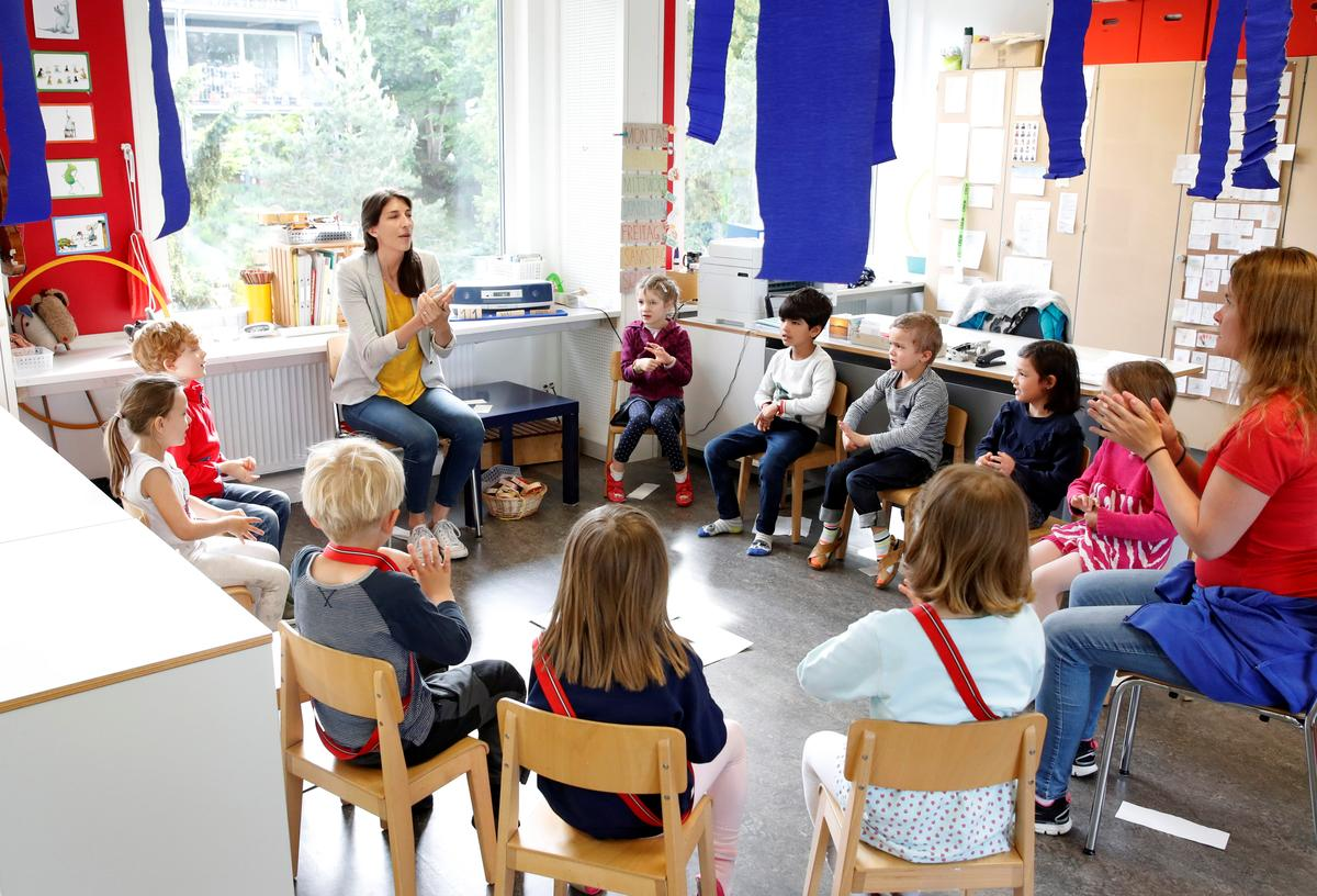 Excited children, anxious parents - Swiss go back to school